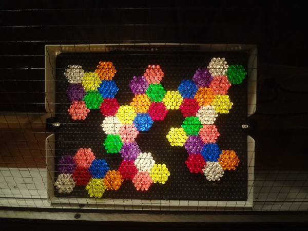More hexagonal patterns, this time in Lite-Brite