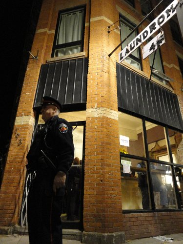 A police officer not required to fend off angry protesters outside the Mulberry Street Coffeehouse