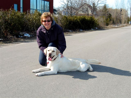 Mary Lou Tanner and her dog, Finnegan, demonstrate the use of Hamilton's Waterfront Trail