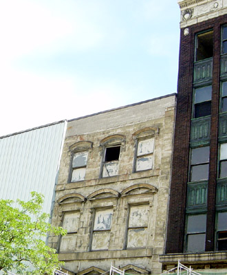 The Thomas Building, built 1854, is not depicted in the new rendering