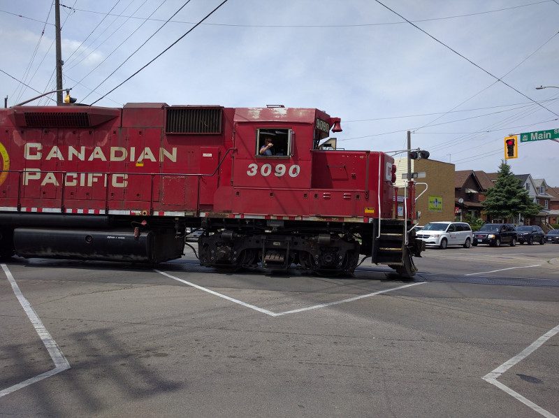 Train engine crossing diagonally through Main and Gage intersection
