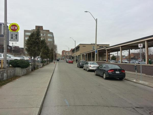 Rebecca Street between Catharine and John: two-way traffic, curbside parking, sky remains firmly in place