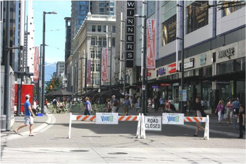 All summer long open streets on Granville. Note the absence of police officers controlling traffic and the simple barriers. Viva Vancouver is bringing open streets to many Vancouver neighbourhoods all summer long.