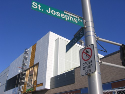 'Pedestrians Cross Other Side' sign on the north side of St. Joseph's Drive at James