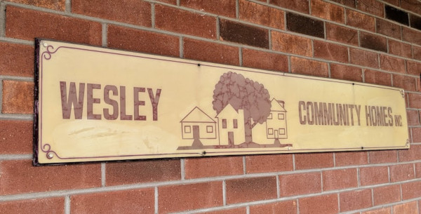 Wesley Community Homes Inc. sign