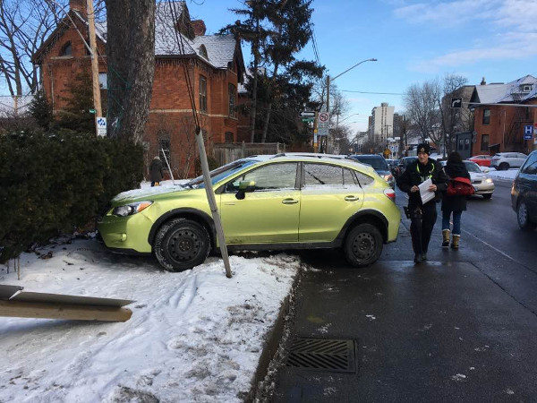 Car sitting across Queen Street sidewalk on February 6, 2018 (Image Credit: Maureen Wilson)